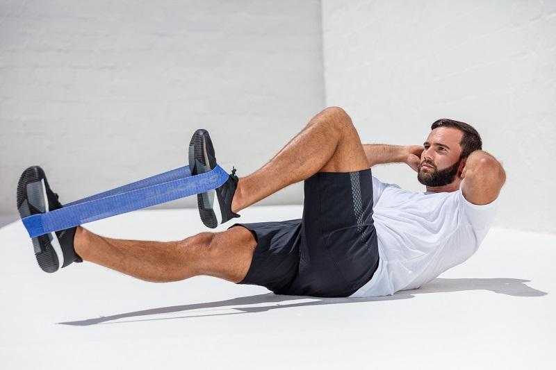 Вправи для м'язів живота з фітнес-гумкою BLACKROLL