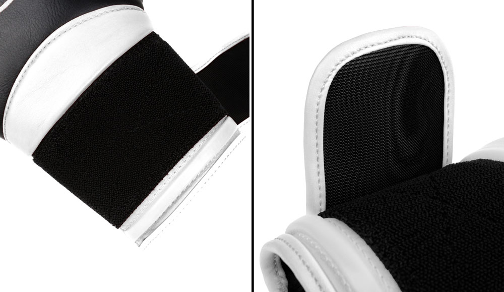 Фиксация черно-белых боксёрских перчаток Dozen Dual Impact