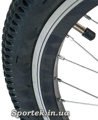 Канавка для контроля износа обода на горном велосипеде