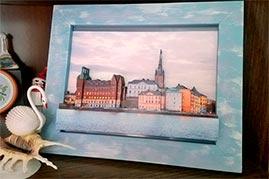 Готовая работа папертоль Вечерний Стокгольм — оформлена в рамку.