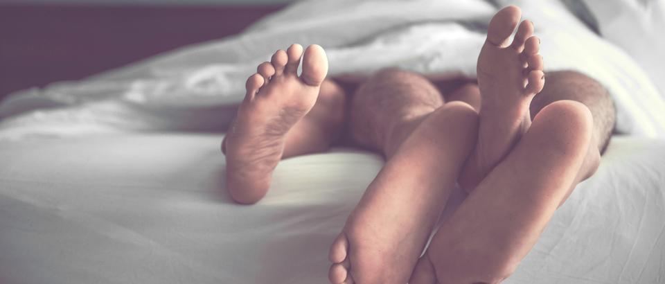 couple-in-bed-feet.jpg
