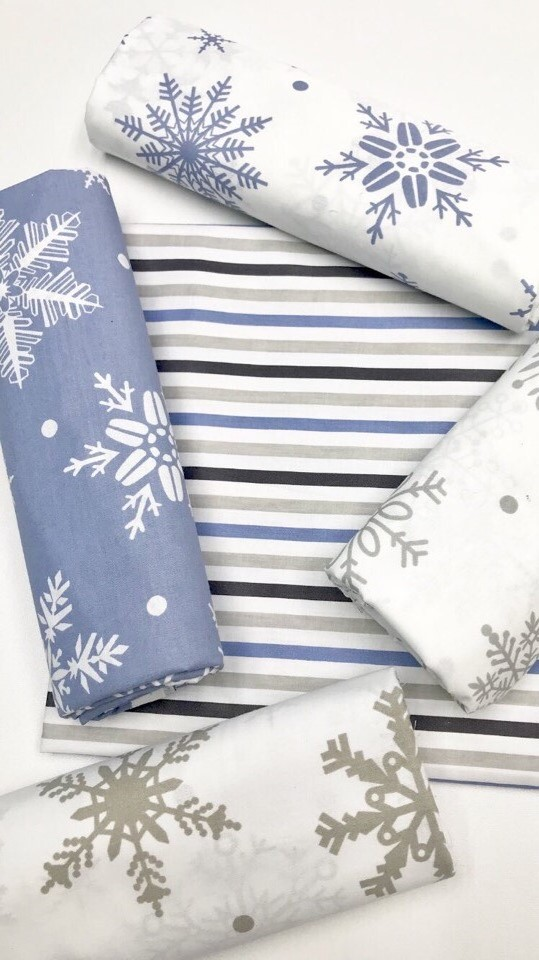 Ткань для шитья со снежинками