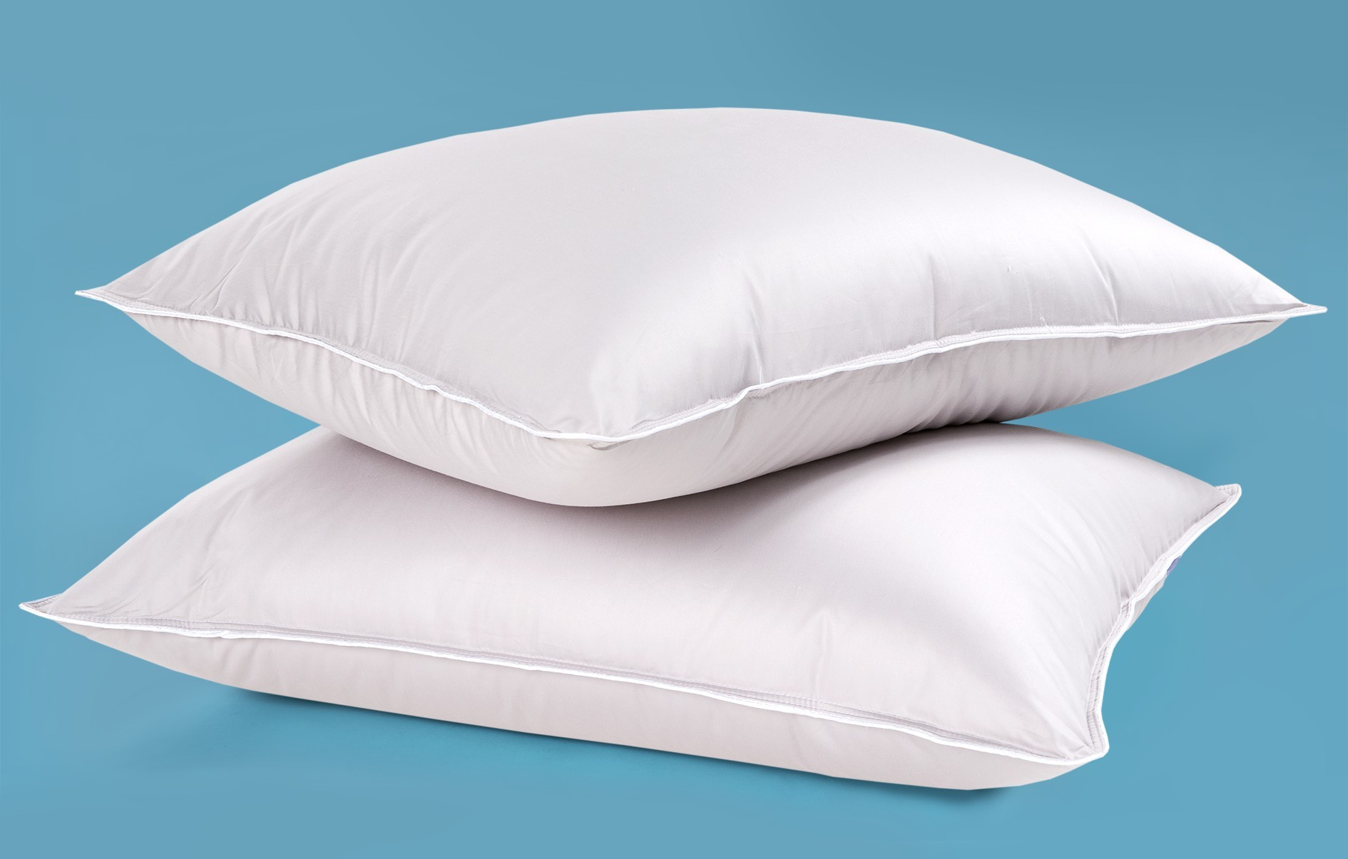 Силиконизированное волокно в подушках и одеялах: плюсы и минусы наполнителя
