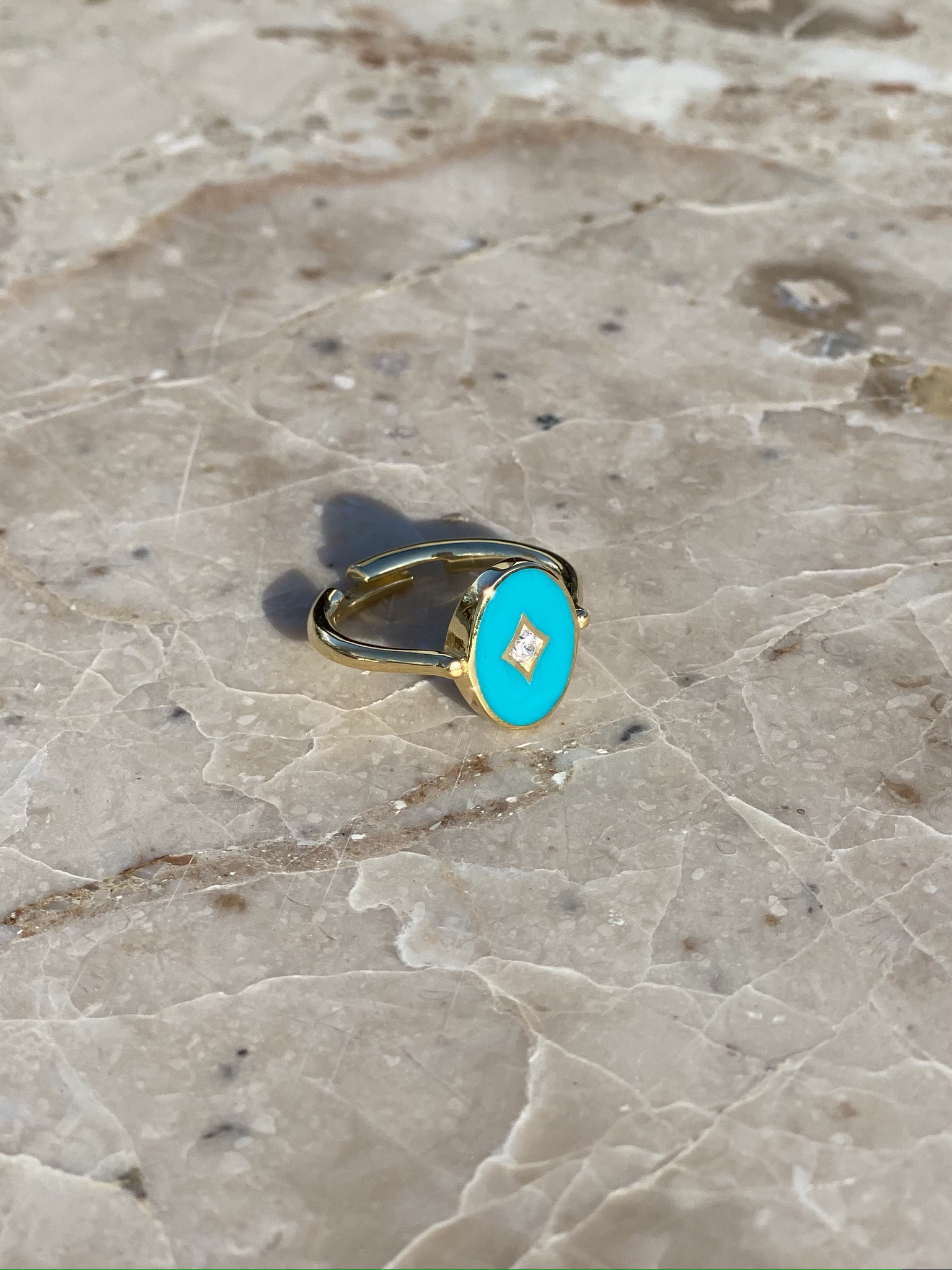 Aurora ring in gold plated silver with light blue enamel