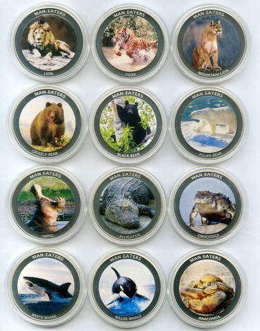 """Набор из 12 монет 100 шиллингов 2010 год Уганда """"Животные людоеды"""""""