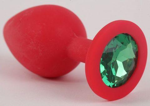 Красная силиконовая анальная пробка с зеленым стразом - 9,2 см.