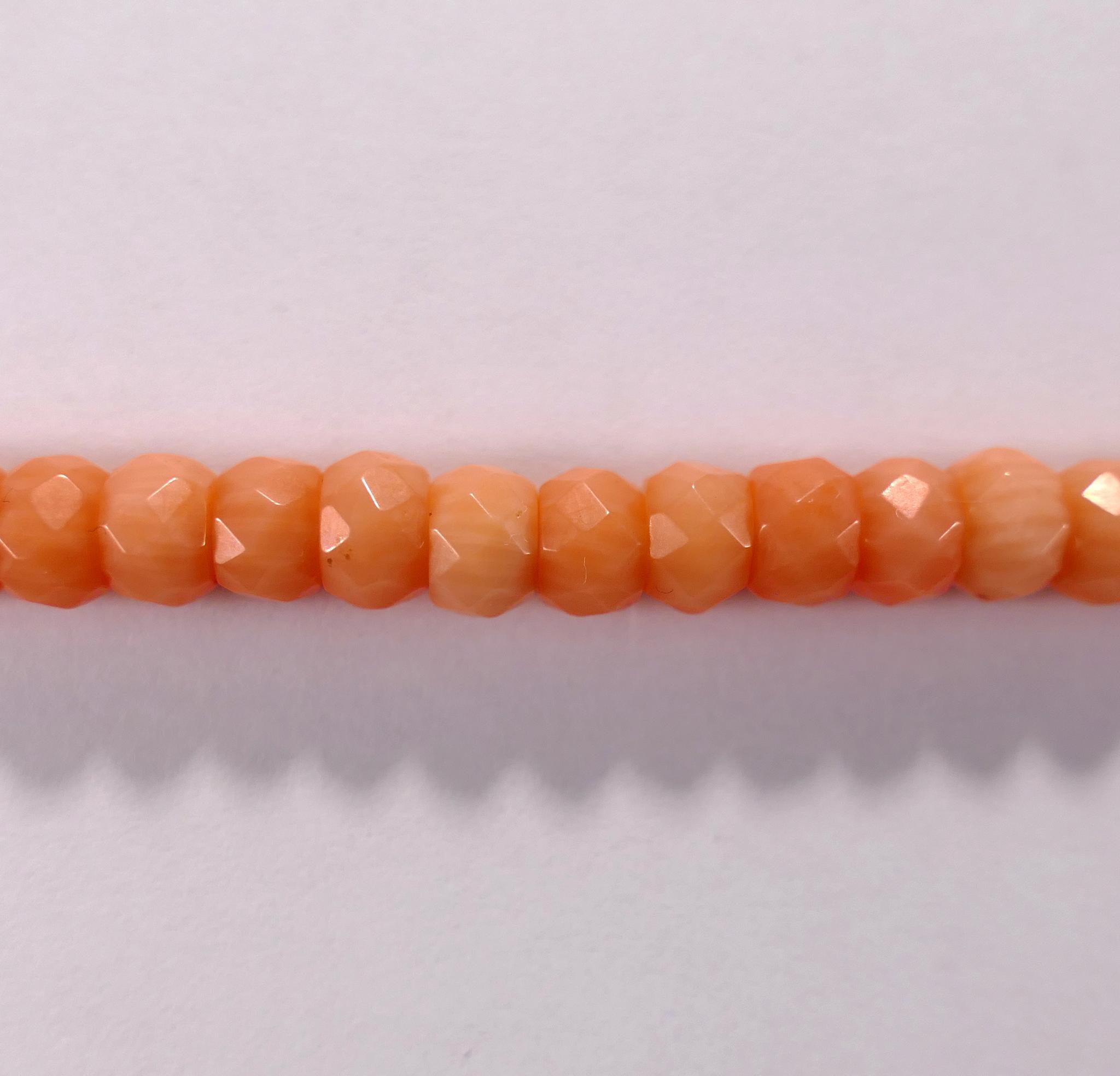 Бусина из коралла розового, фигурная, 4x7 мм (рондель, граненая)