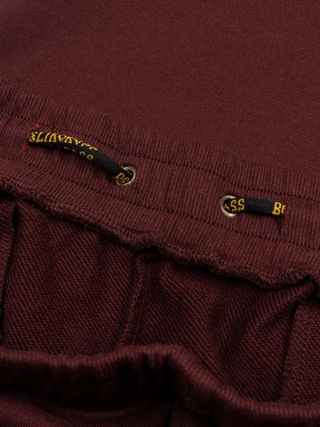Спортивные штаны цвета красного вина  с манжетами, без лампасов. Плотный футер