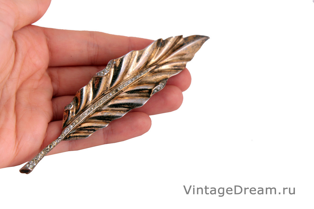 Luxurious silver feather brooch by Trifari, 1942