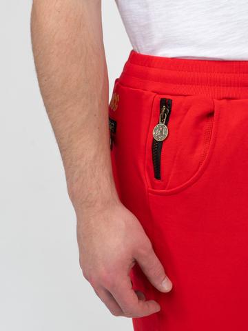 Спортивные штаны красного цвета с манжетами, без лампасов