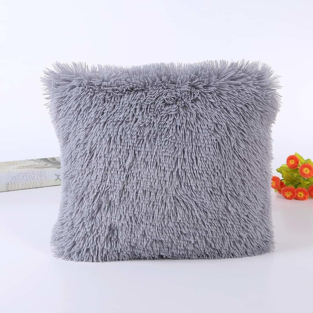 Подушка интерьерная с длинным ворсом светло-серого цвета