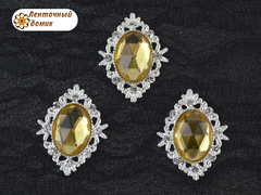 Камни овалы в ромбовой оправе светлое серебро желтые