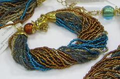 Комплект украшений из бисера янтарно-зеленый (серьги из бисера, бисерный браслет)