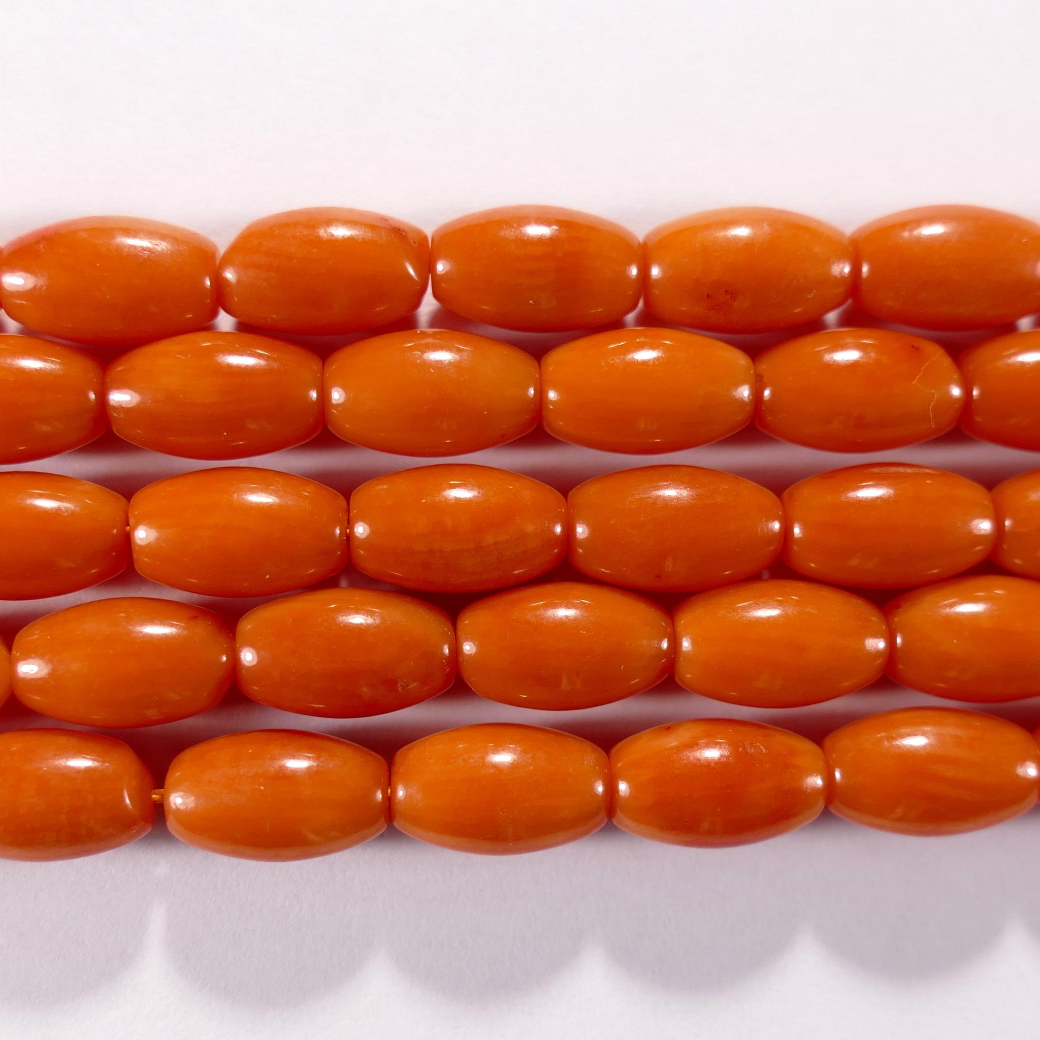 Нить бусин из коралла оранжевого, облагороженного, фигурные, 6x9 мм (овал, гладкая)