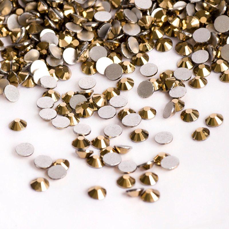 Стразы Стразы Swarovski SS3 (1 мм), золото 50 шт Стразы_Swarovski_SS3__1_мм___золото_50_шт_.jpg