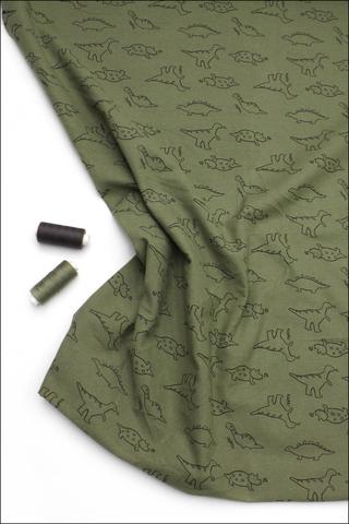 Фланель динозавры на зеленом