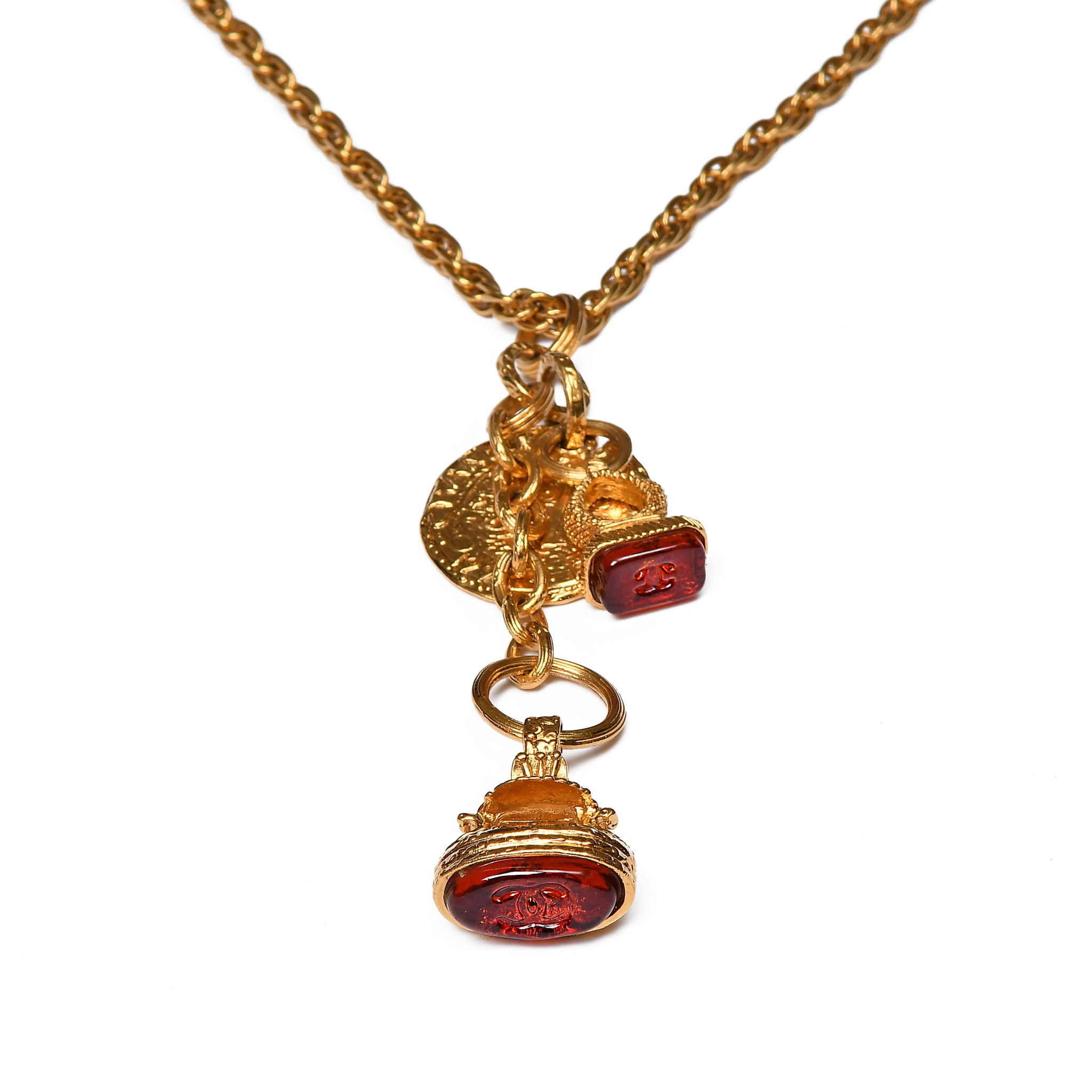 Luxurious long chain necklace with three pendants, two of which are shaped as seals, with Gripoix glass