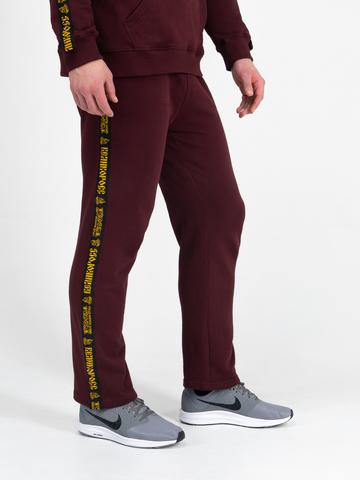 Спортивные штаны цвета красного вина с лампасами, без манжета