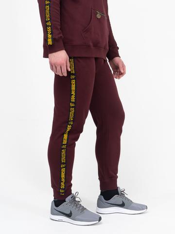 Спортивные штаны цвета красного вина с лампасами, с манжетами. Плотный футер