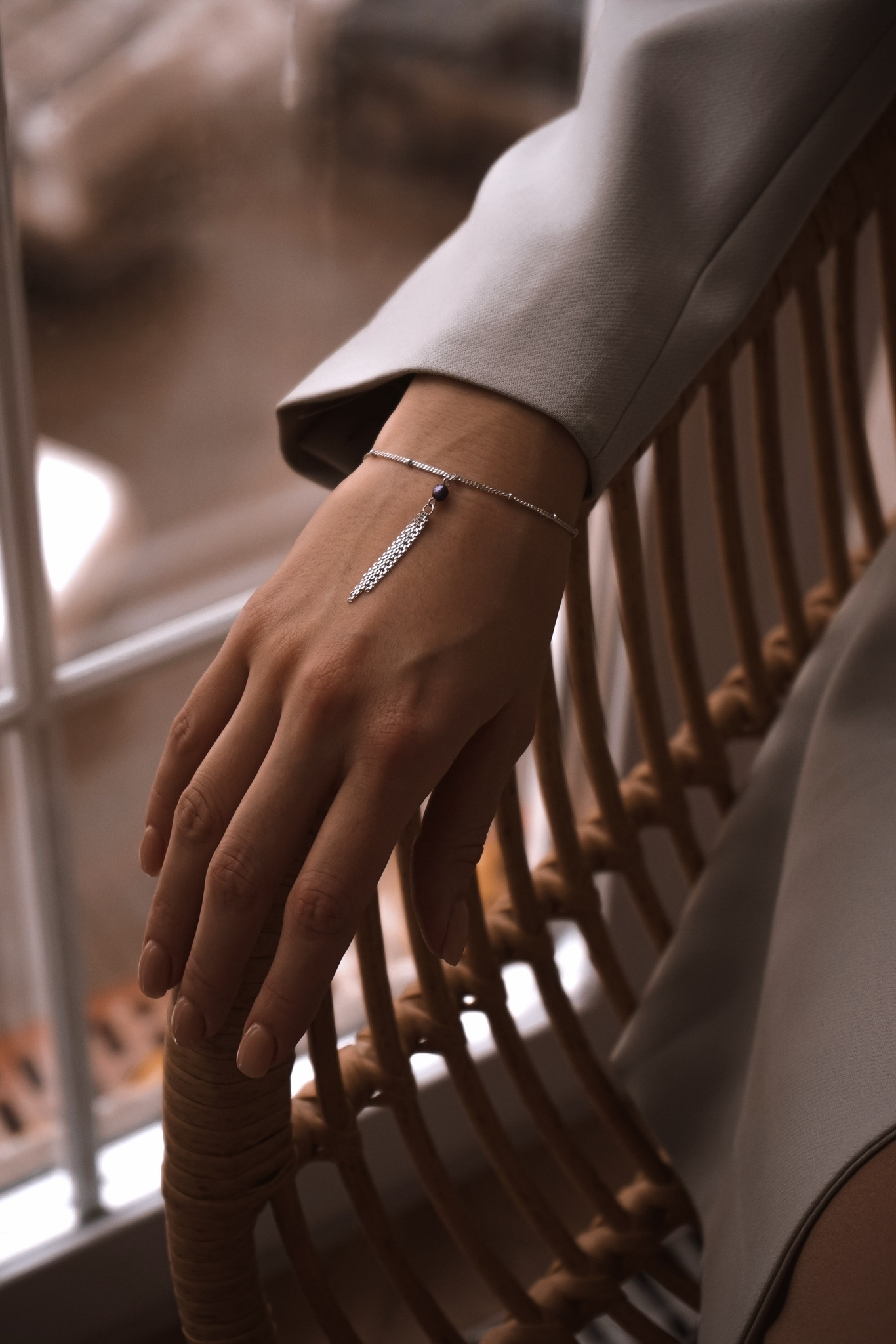 Серебряный браслет с кистью