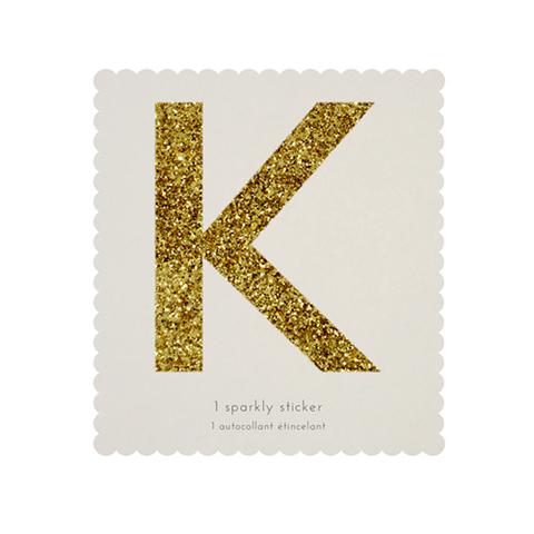 Стикер K, мерцающее золото