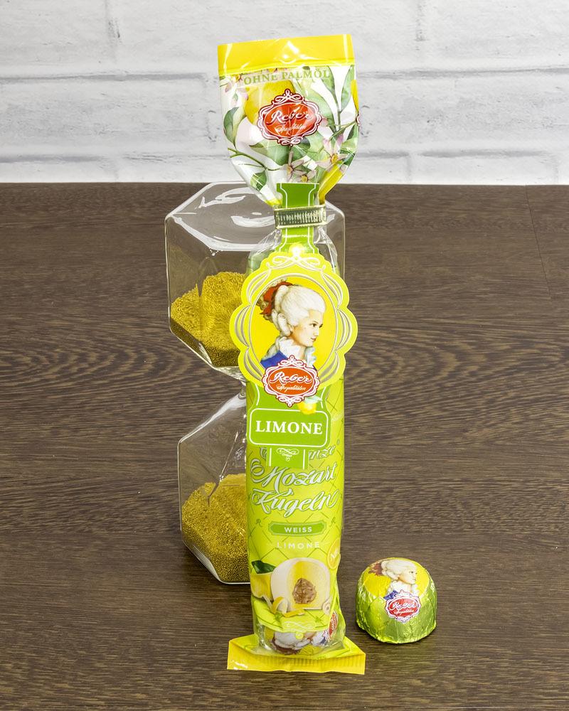 Конфеты Шоколадные Reber из Белого Шоколада с Ореховым Пралине, Марципаном и Лимонной Начинкой 100 гр.