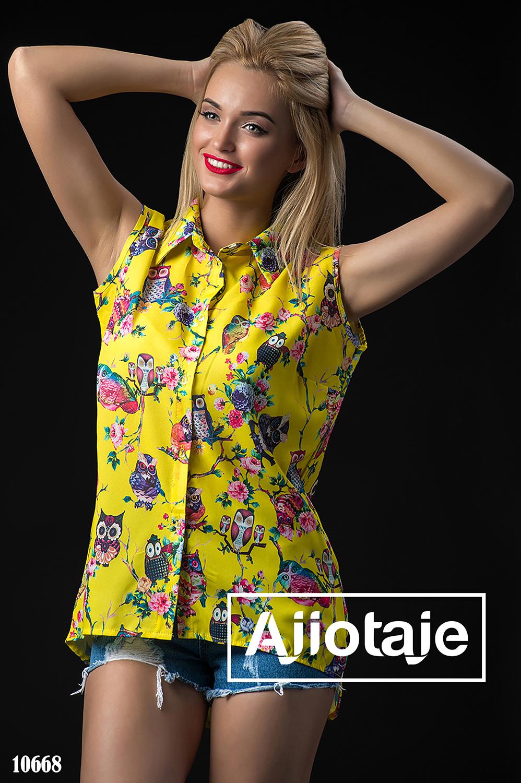 Блузка желтого цвета без рукавов