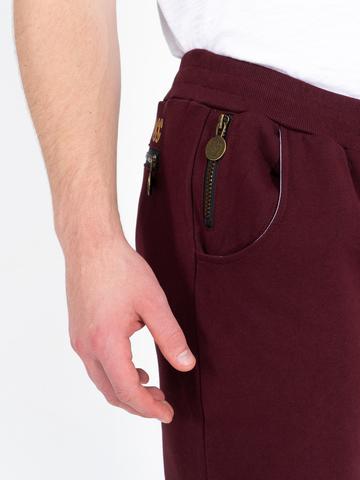 Спортивные штаны цвета красного вина  без лампасов, без манжета