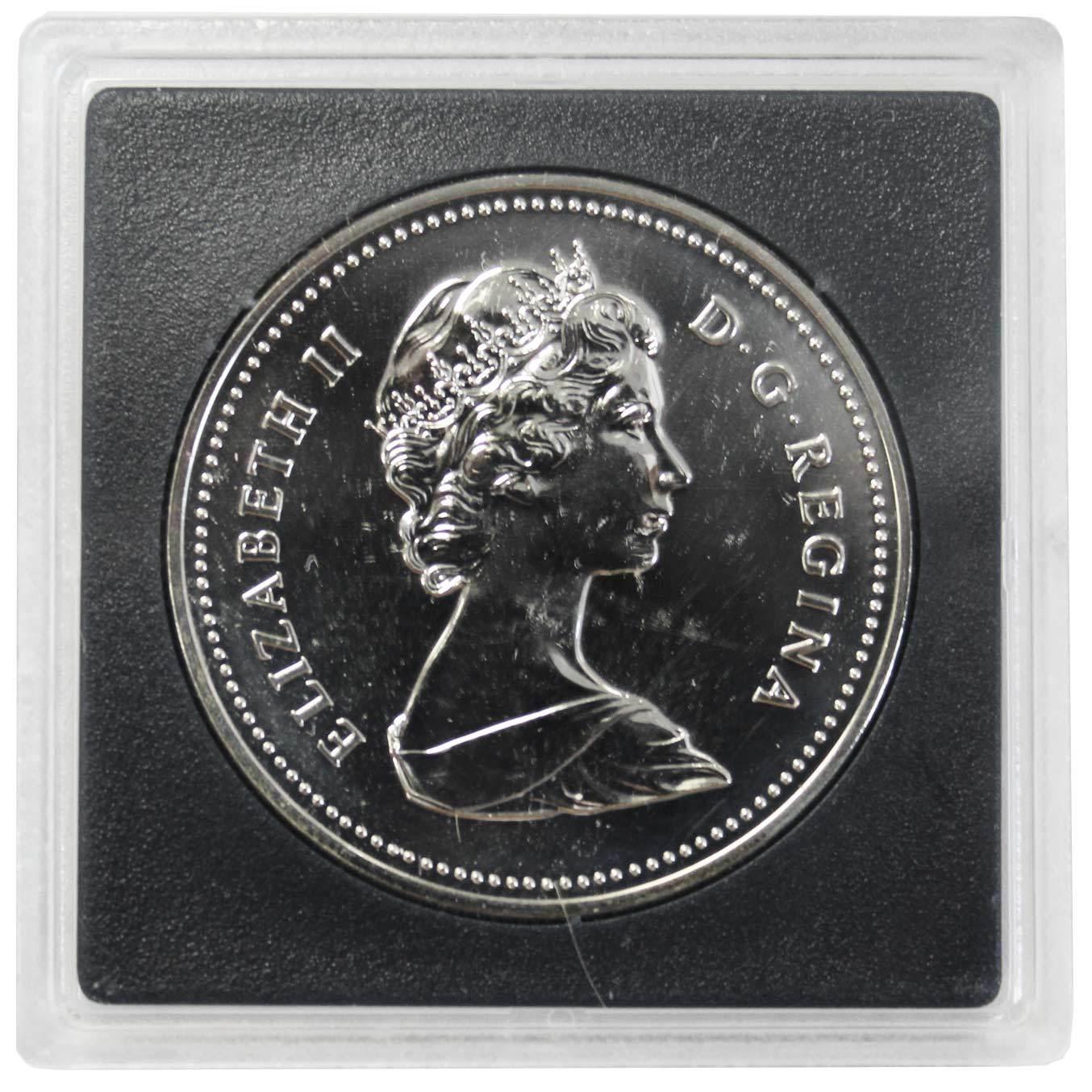 1 доллар. XII Универсиада в Эдмонтоне. Канада. Серебро. 1983 г. BrUNC. В оригинальной квадрокапсуле