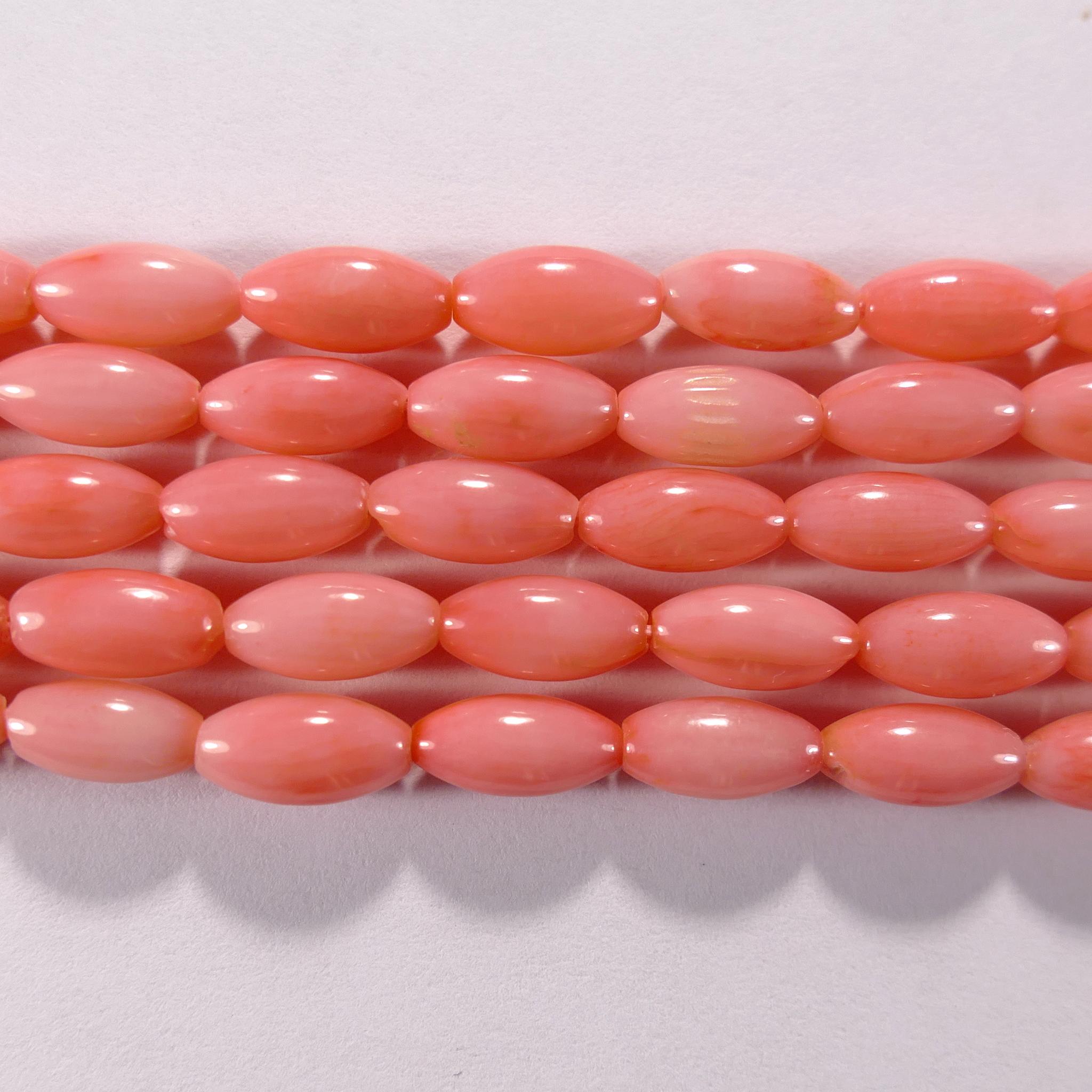 Нить бусин из коралла розового, фигурные, 4x8 мм (овал, гладкая)