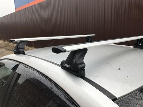Багажник Интер на крышу Hyundai Solaris I 2010-2017 хэтчбек 8895 крыловидные дуги 120 см.