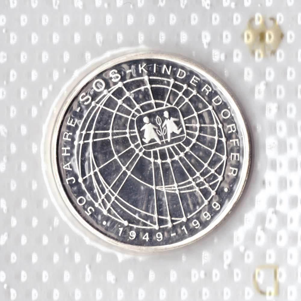 10 марок. 50 лет благотворительной организации по поддержке детей сирот (D). Серебро. 1999 г. PROOF
