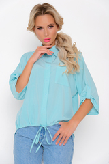 """<p>Модная рубашка """"Люсия"""" в насыщенной цветовой гамме будет базовой вещью вашего нового гардероба. Ворот отложной на стойке, рукав 3/4 с патой на пуговице, по переду планка с пуговицами, низ на кулиске.&nbsp;</p>"""