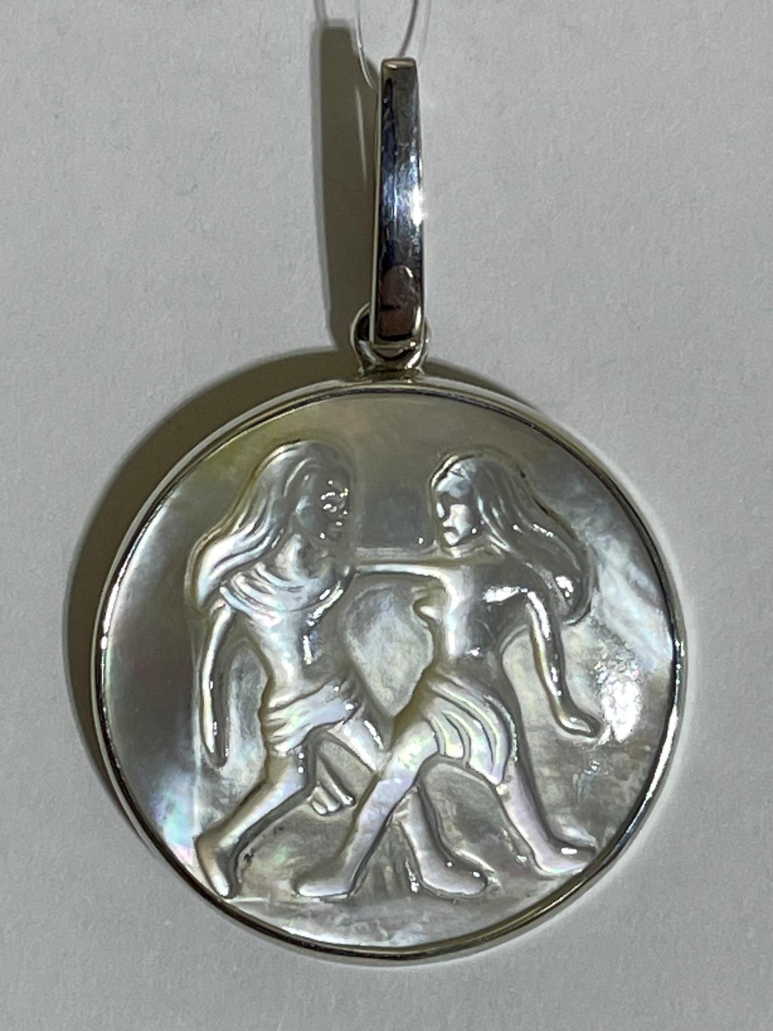 Близнецы  (кулон из серебра)