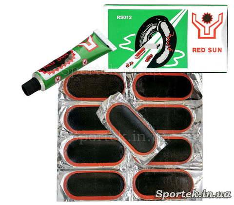 Ремкомплект для ремонту велосипедних камер і гумових виробів: 8 гумових латок (10х4,5 см) і клей