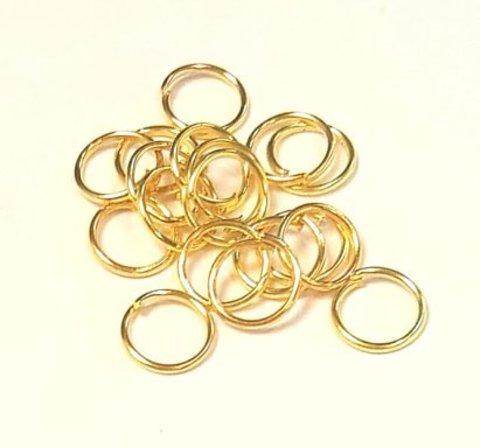 Кольцо одинарное 7 мм золото цена за 25 шт