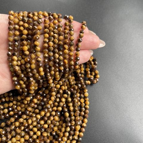 Бусины тигровый глаз А граненый 4,5 мм цена за 45 бусин (~19 см)