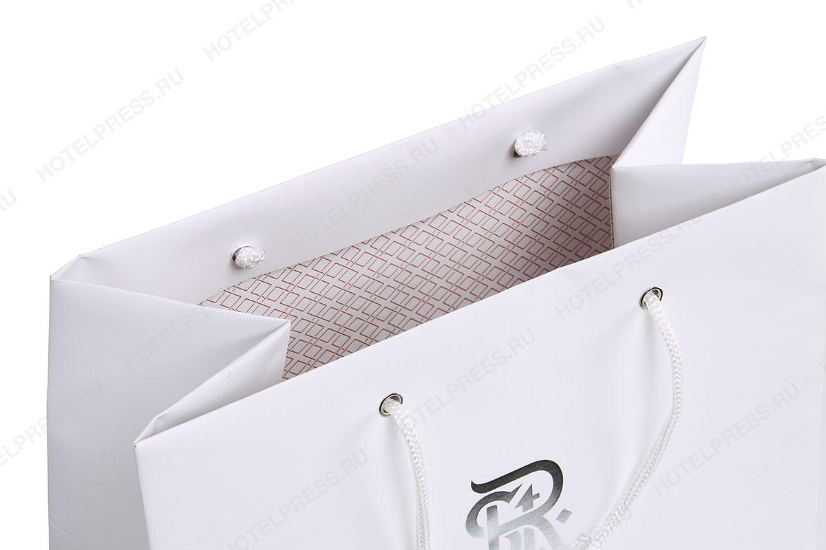 Фирменный пакет с тиснением серебренной фольгой и внутренней печатью