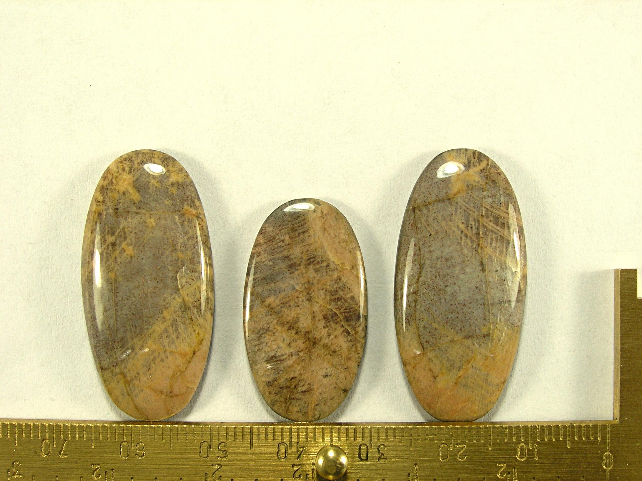 Комплект кабошонов солнечного камня 35x17x4 - 2 шт., 28x16x3 - 1 шт.