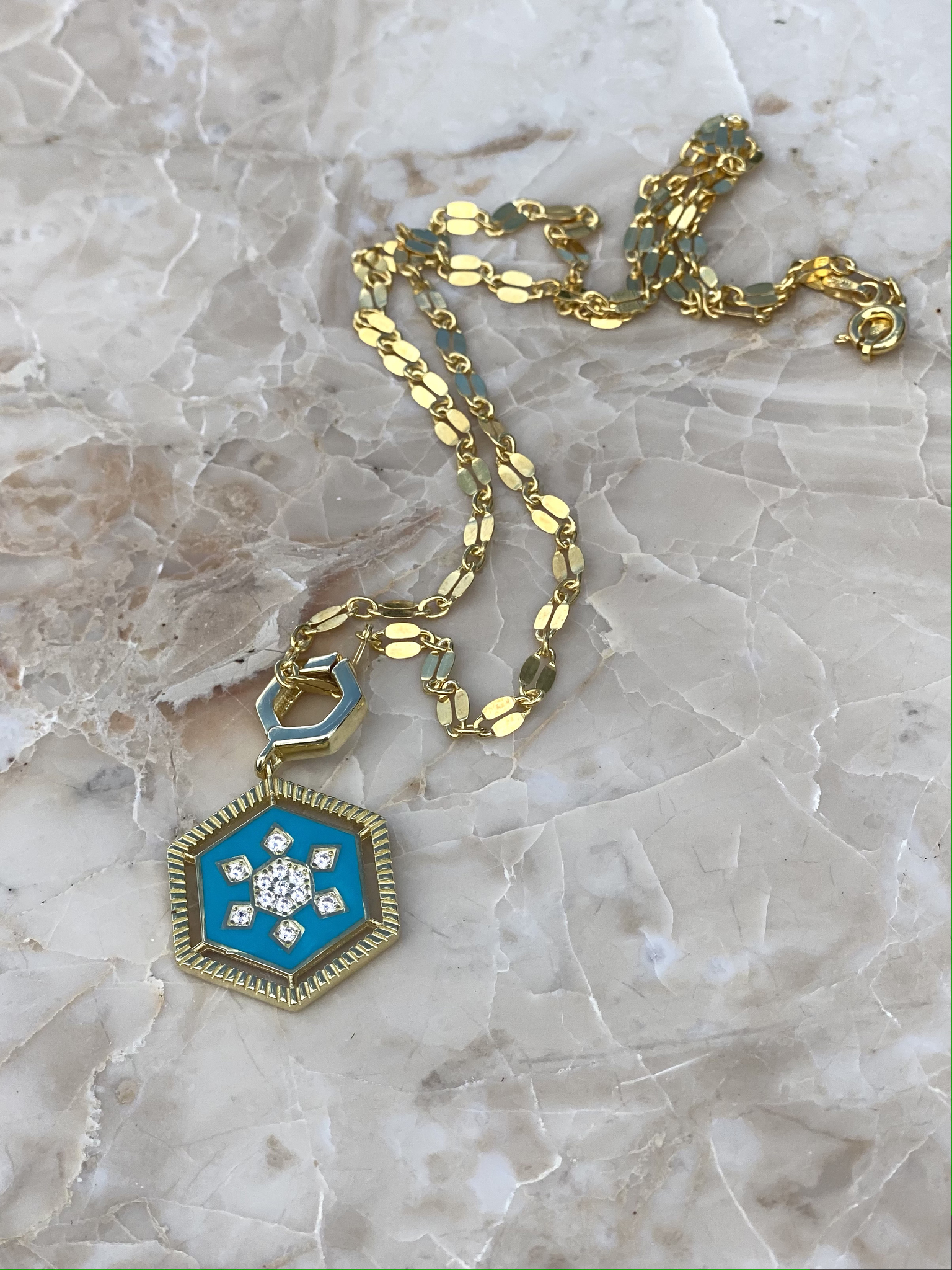 Necklace in gold plated silver with light blue enamel