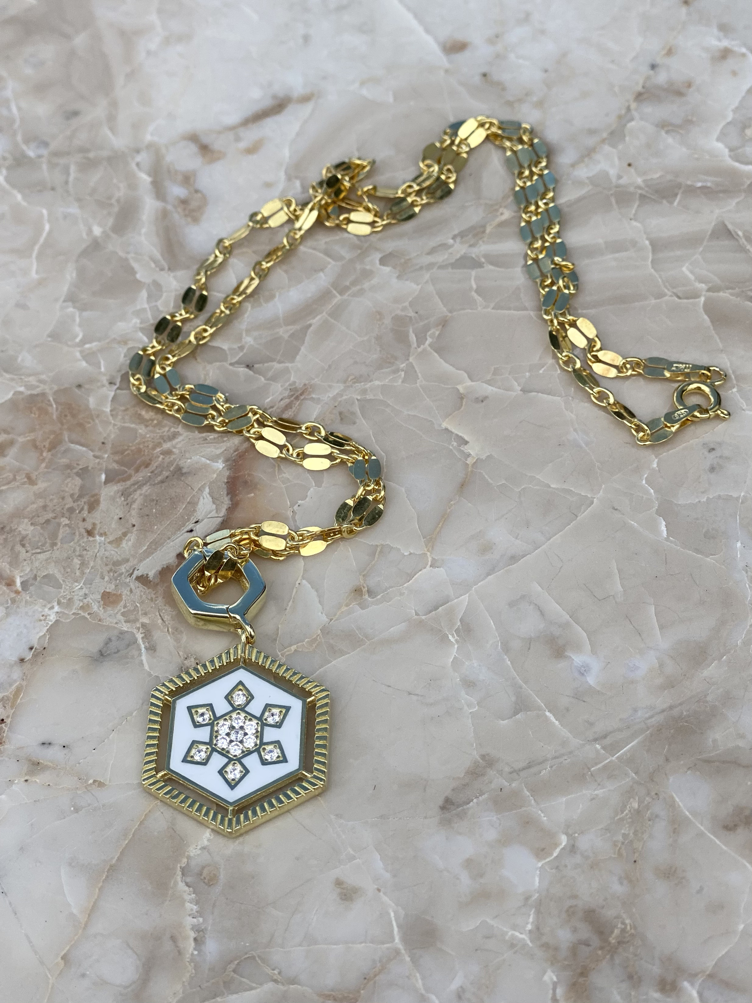 Necklace in gold plated silver with light white enamel