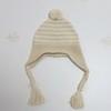 Вязаная шапочка на завязках для новорожденного