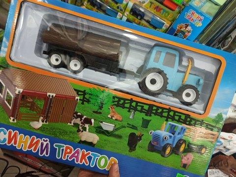 Синий трактор с глазами и животными большой