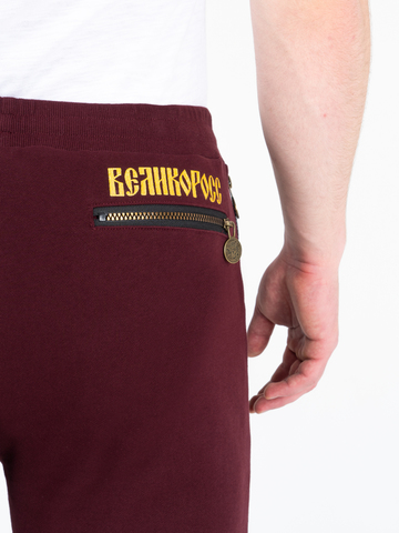 Спортивные штаны цвета красного вина  с манжетами, без лампасов
