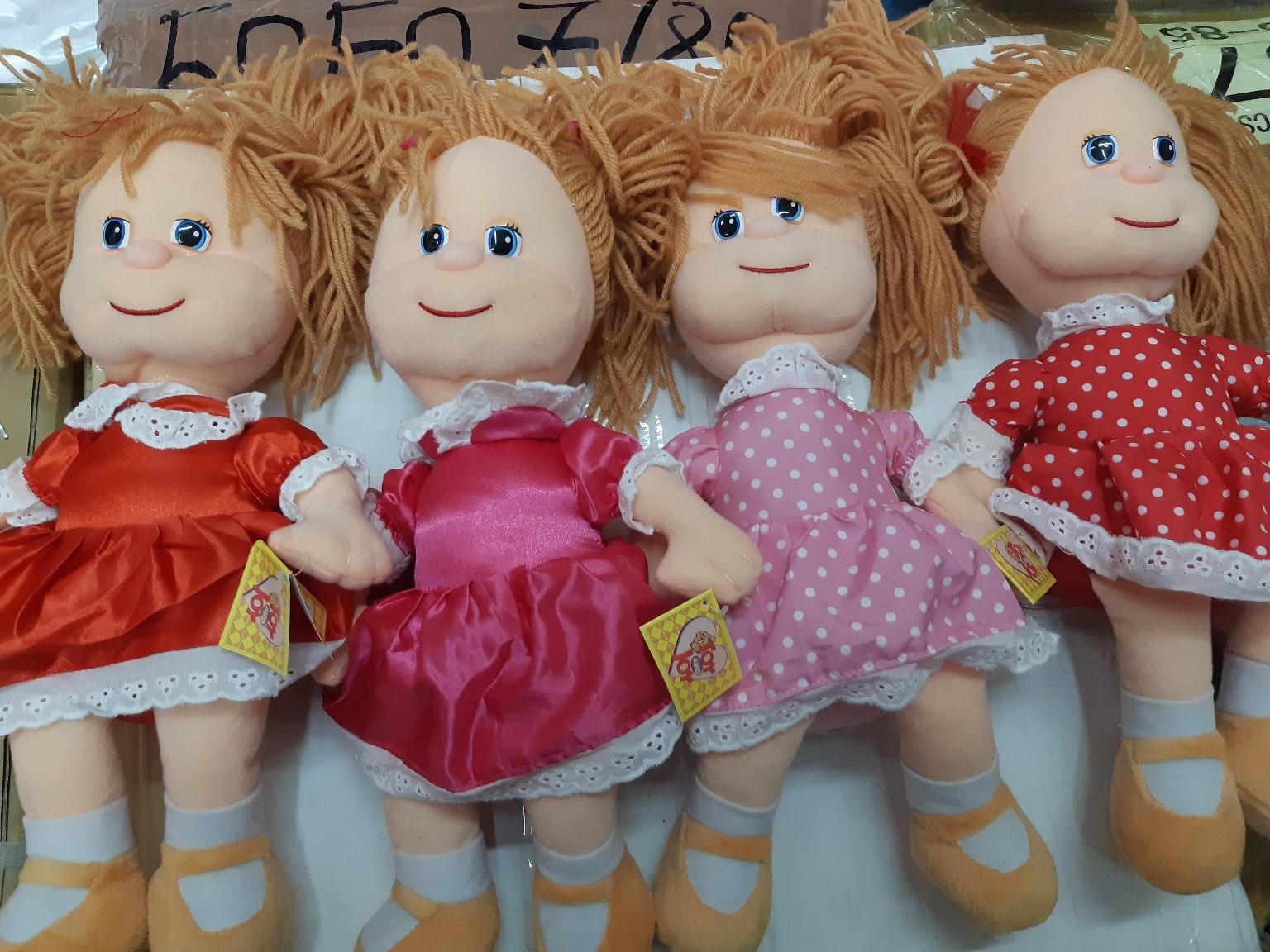 Мягкая музыкальная кукла в платье в четырёх расцветках