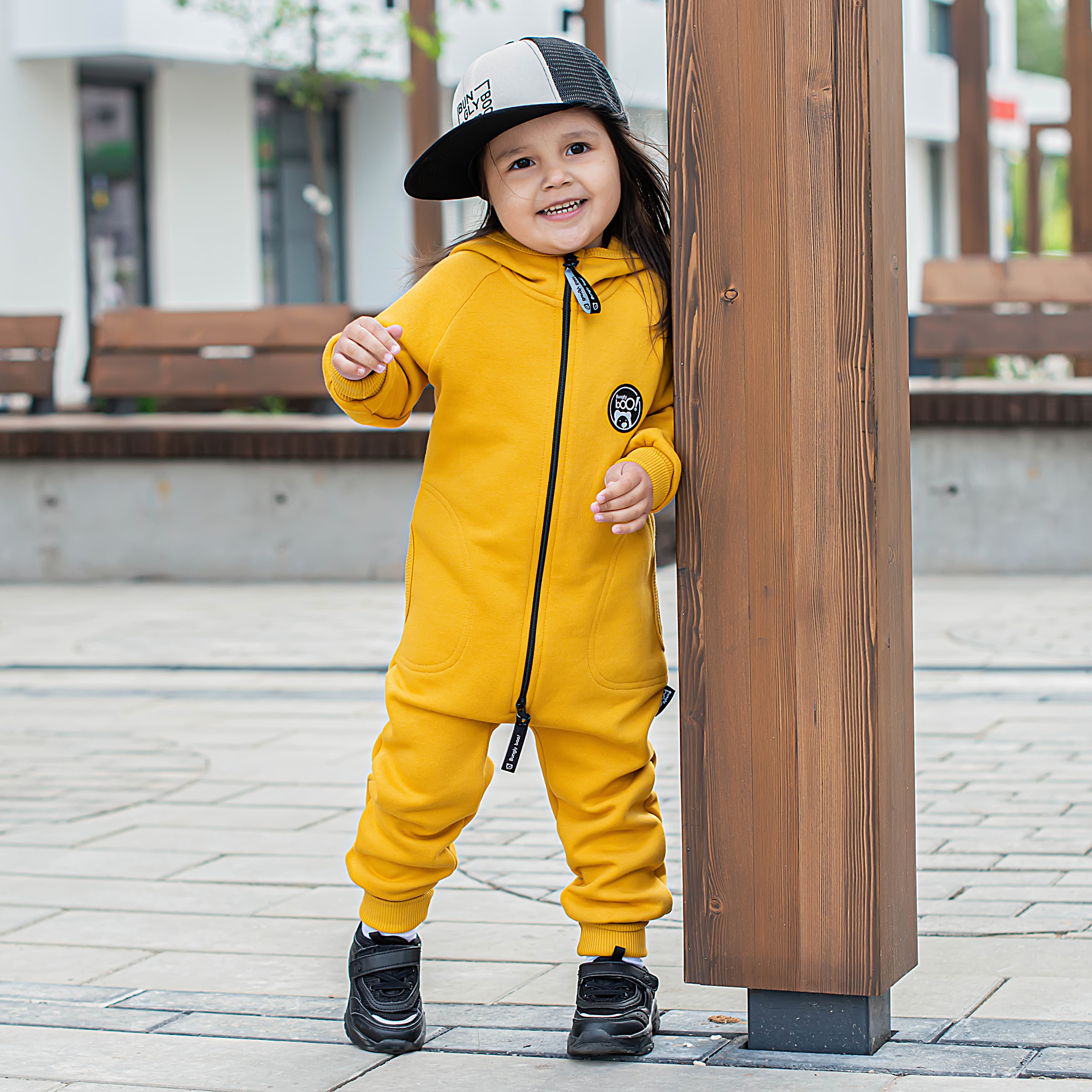 Warm hooded jumpsuit with side pockets - Mustard