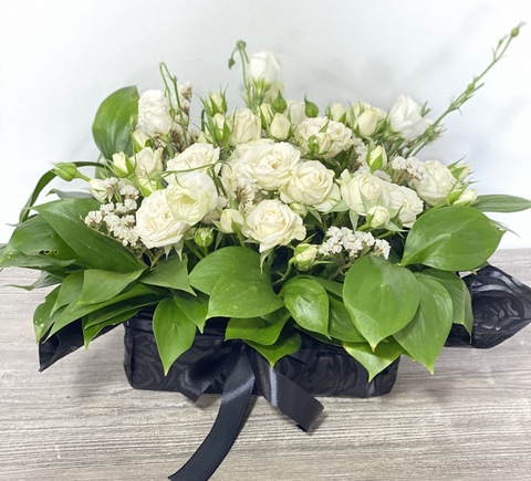 A Funeral Arrangement with White Roses
