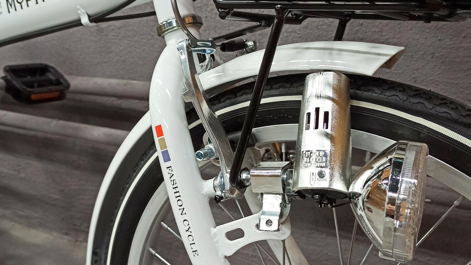 Вилка переднего колеса и фонарь складного велосипеда