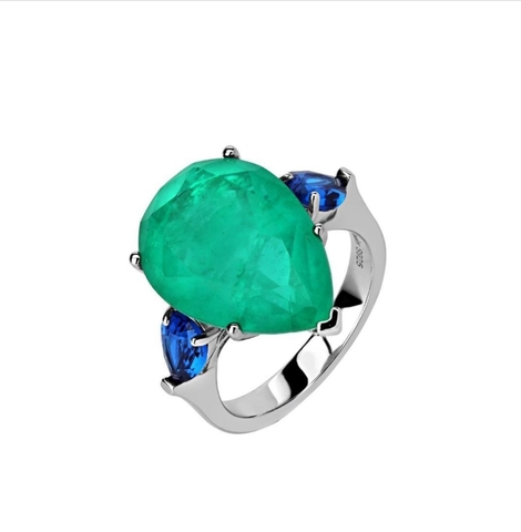 47444- Кольцо из серебра с кварцем цвета парабаиба огранки кушон и синими цирконами
