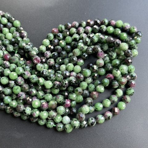 Бусины цоизит A граненый 6,3 мм цена за 30 бусин (~19 см)